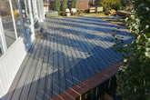 Custom composite decking, staggered deck boards with double bordered trim.