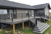 Stairs and composite deck with railings.